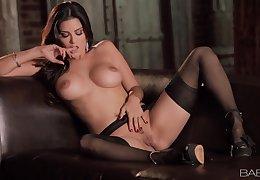 Sunny Leone spreads her legs and masturbates relating to stockings