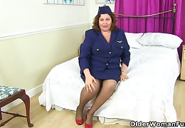 English milf Vintage Hell-cat looks very dispirited about a stewardess outfit